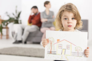 little boy with house drawing